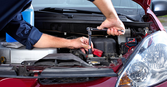 Mechanic working on a battery
