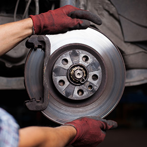 Automotive Car Repair in Merrillville, Indiana - Mechanic fixing brakes
